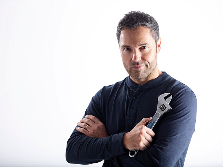 Male model posing with a spanner for a video for Bott Smartvan.