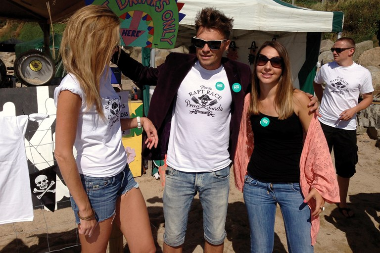 Simon selling his T-shirts to support Shelter Box, Praa Sands Pirate Raft Race