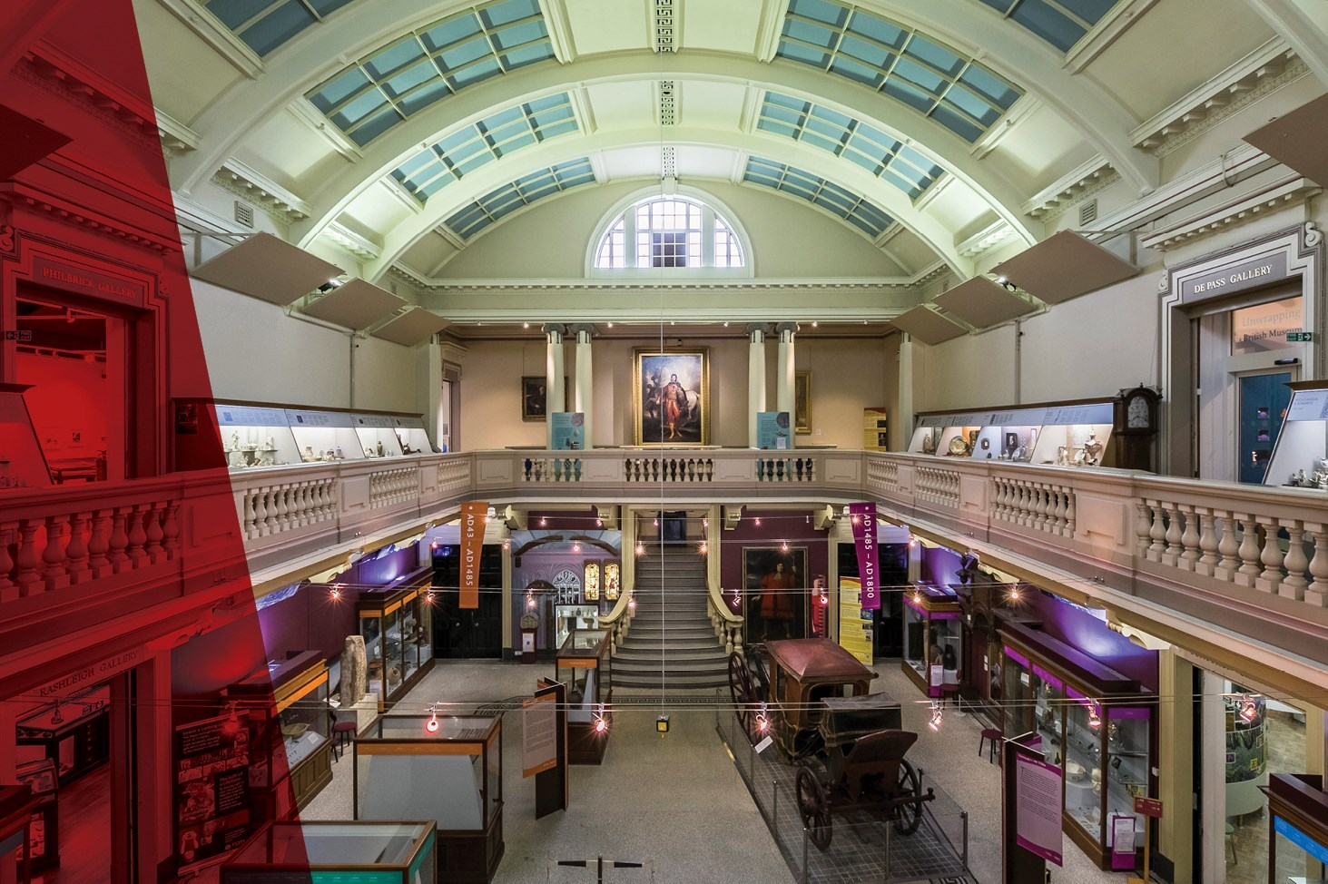 The main hall of the Royal Cornwall Museum.  A high glass ceiling and lots of exhibitions